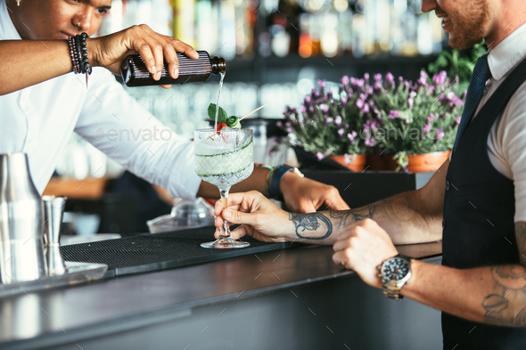 Serving cocktail at the bar counter - Stock Photo - Images