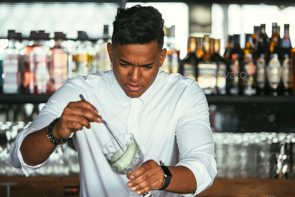 Expert bartender prepares cocktail - Stock Photo - Images