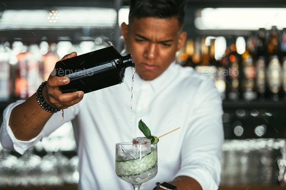 Barman adding alcohol - Stock Photo - Images