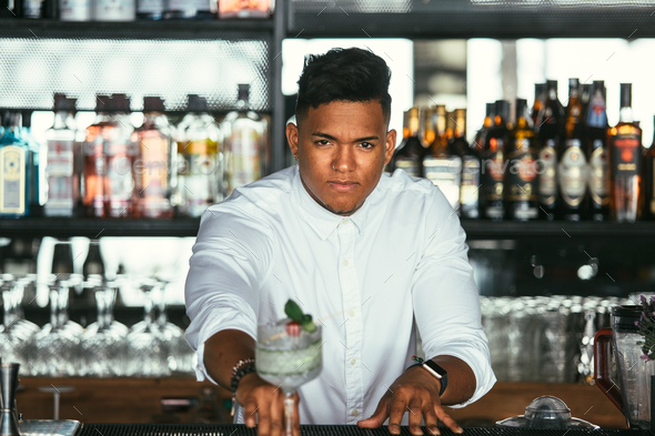 Bartender presents a cocktail - Stock Photo - Images