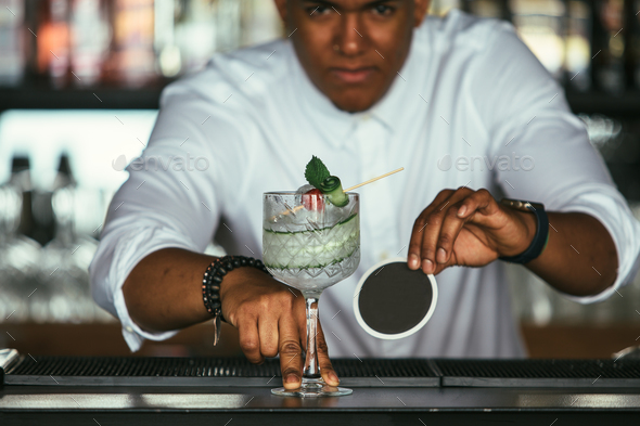 Cocktail served by an expert bartender - Stock Photo - Images