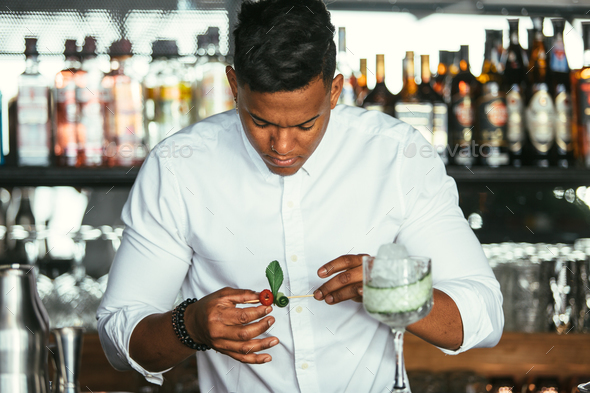 Male bartender preparing cocktail - Stock Photo - Images