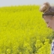 Farmer Examining Rapeseed Blooming Plants - VideoHive Item for Sale