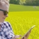Farmer Touching Screen Of Digital Tablet At Rapeseed Field - VideoHive Item for Sale