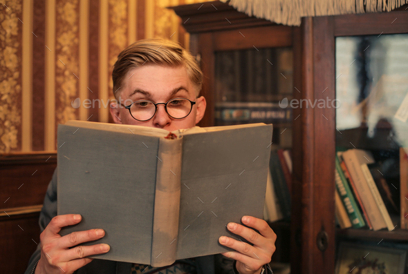 Boy reading a book - Stock Photo - Images