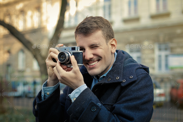 Man with a vintage camera - Stock Photo - Images