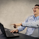Laughing man in front of a laptop - PhotoDune Item for Sale