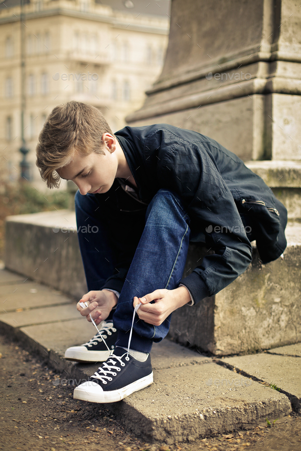 Boy getting his shoes on - Stock Photo - Images