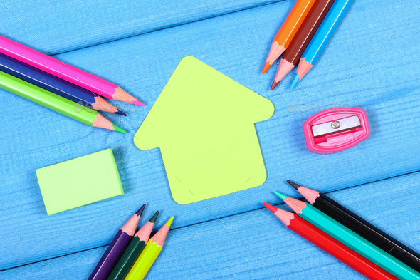 School accessories and shape of building on blue boards, copy space for text - Stock Photo - Images