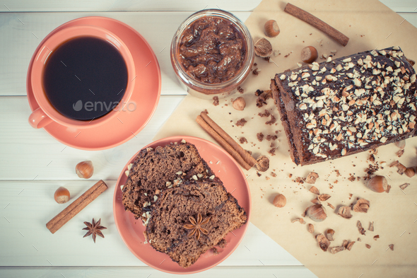 Vintage photo, Dark cake with chocolate, cocoa and plum jam, cup of coffee, delicious dessert - Stock Photo - Images