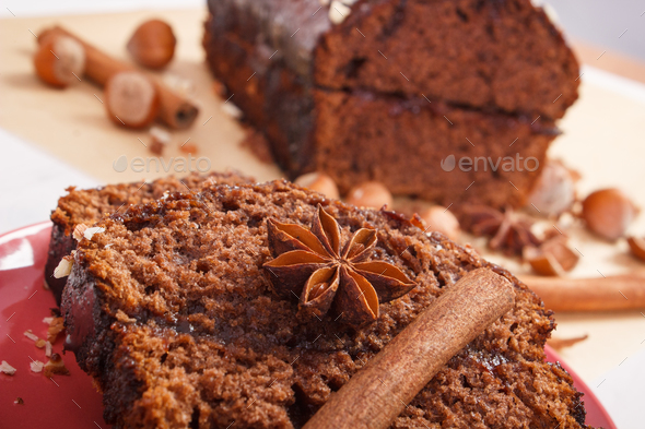 Gingerbread or dark cake with chocolate, cocoa and plum jam, delicious dessert - Stock Photo - Images