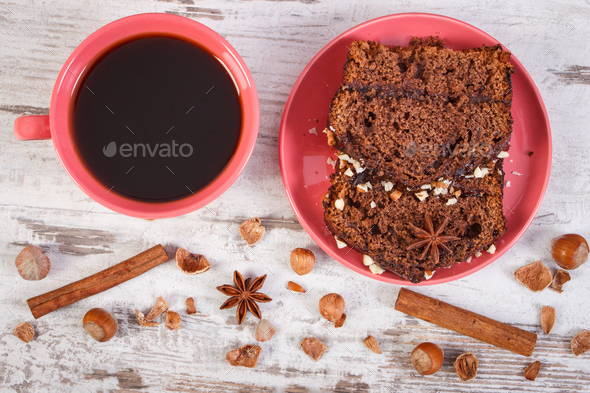 Black coffee, dark cake with chocolate, cocoa and plum jam - Stock Photo - Images