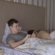 Man with Telephone and Naked Woman Lying on the Bed - VideoHive Item for Sale