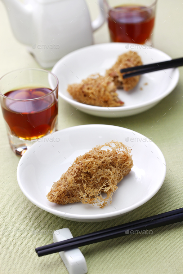 deep fried honeycomb taro dumplings, chinese dim sum and shaoxing wine - Stock Photo - Images
