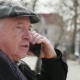 Cheery Old Man Talks on His Smartphone with His Friend in Early Spring  - VideoHive Item for Sale