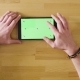 Male Hand Scrolling a Tablet with Green Screen - VideoHive Item for Sale