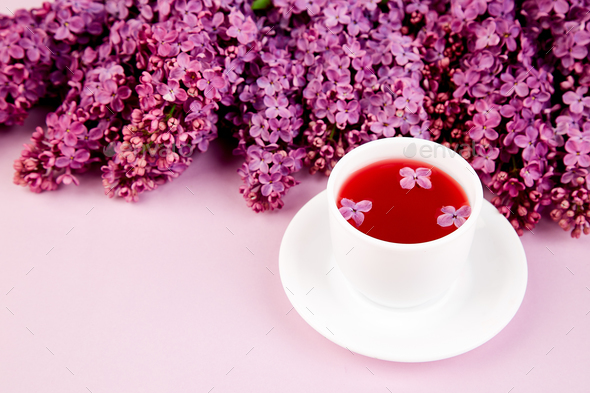 Cup of tea and bouquet  lilac - Stock Photo - Images