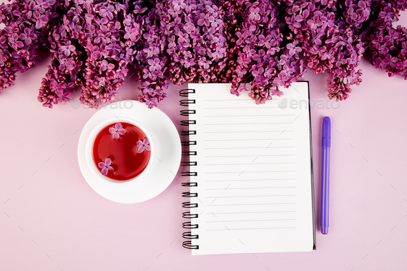 Cup of tea, diary and bouquet  lilac - Stock Photo - Images