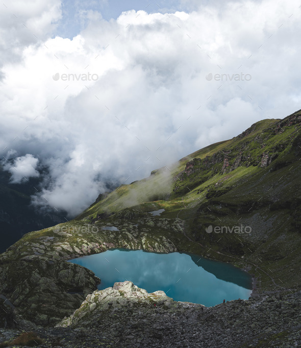 Deep Blue Lake in the Swiss Alps - Stock Photo - Images