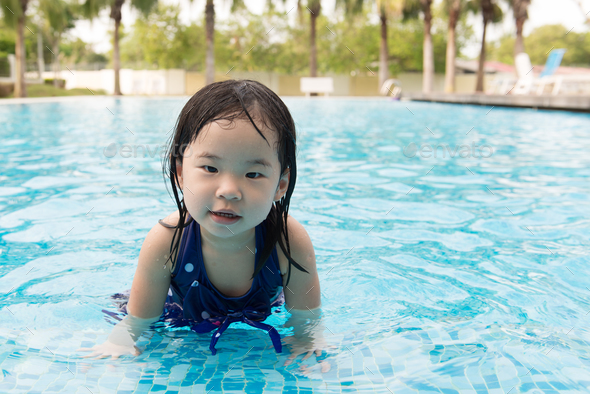 Asian little baby girl in swimming pool - Stock Photo - Images