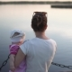 Mother with Baby in Hands Showing Something Far Away, Watching Sunset - VideoHive Item for Sale