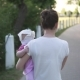 Mother Walking with Child in Hands in the Park with Road and Trees - VideoHive Item for Sale
