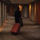 Hotel Guest with Trolley Case Walking To the Room - VideoHive Item for Sale