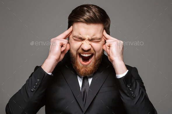 Close up portrait of a screaming young businessman - Stock Photo - Images