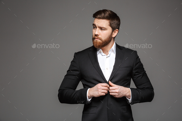 Portrait of a confident young businessman - Stock Photo - Images