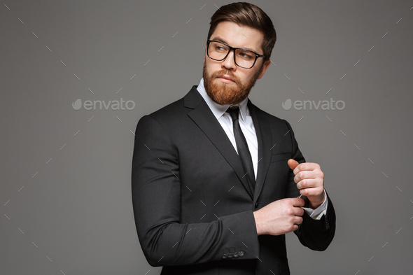Portrait of a confident young businessman dressed in suit - Stock Photo - Images