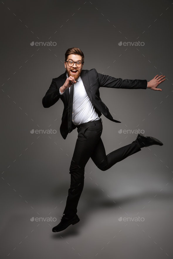 Full length portrait of a happy young businessman - Stock Photo - Images