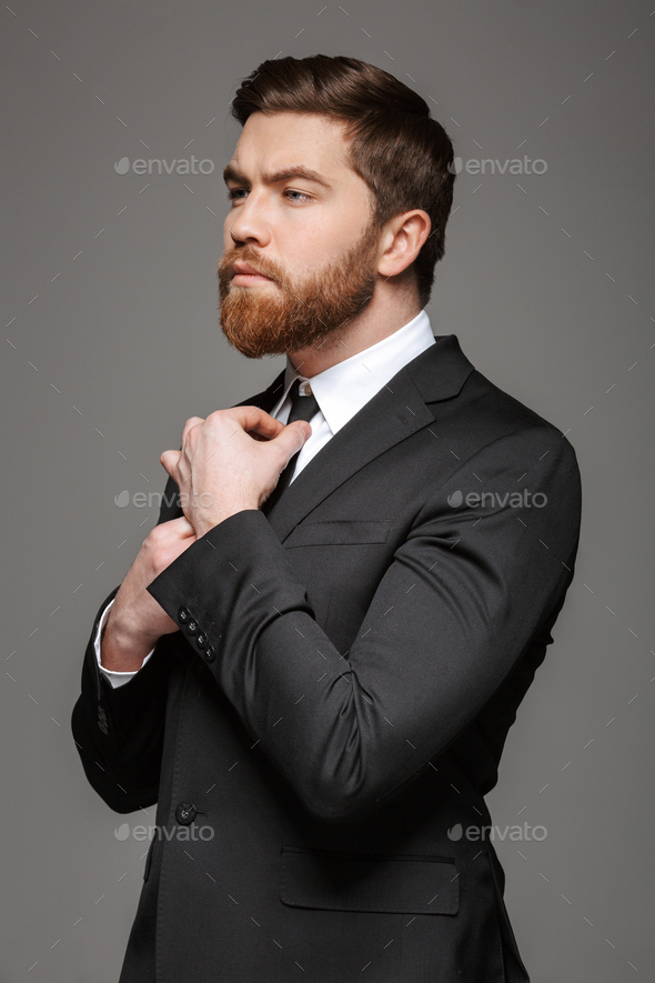 Portrait of a handsome young businessman dressed in suit - Stock Photo - Images