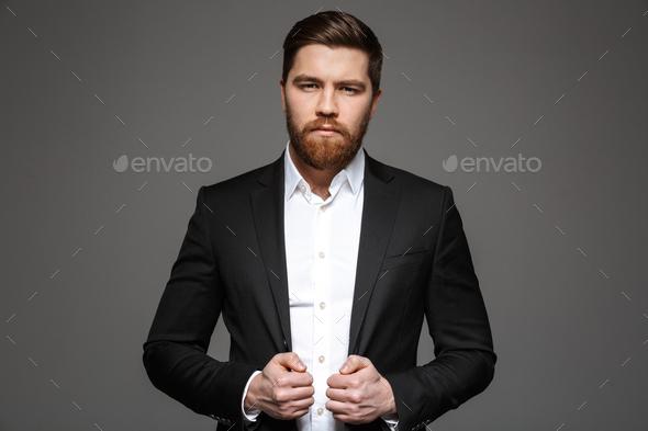 Portrait of a confident young businessman - Stock Photo - Images