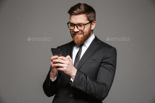 Portrait of a happy young businessman dressed in suit - Stock Photo - Images