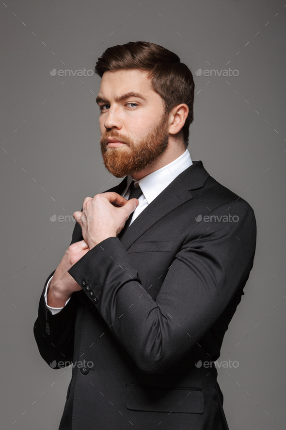 Portrait of a serious young businessman - Stock Photo - Images