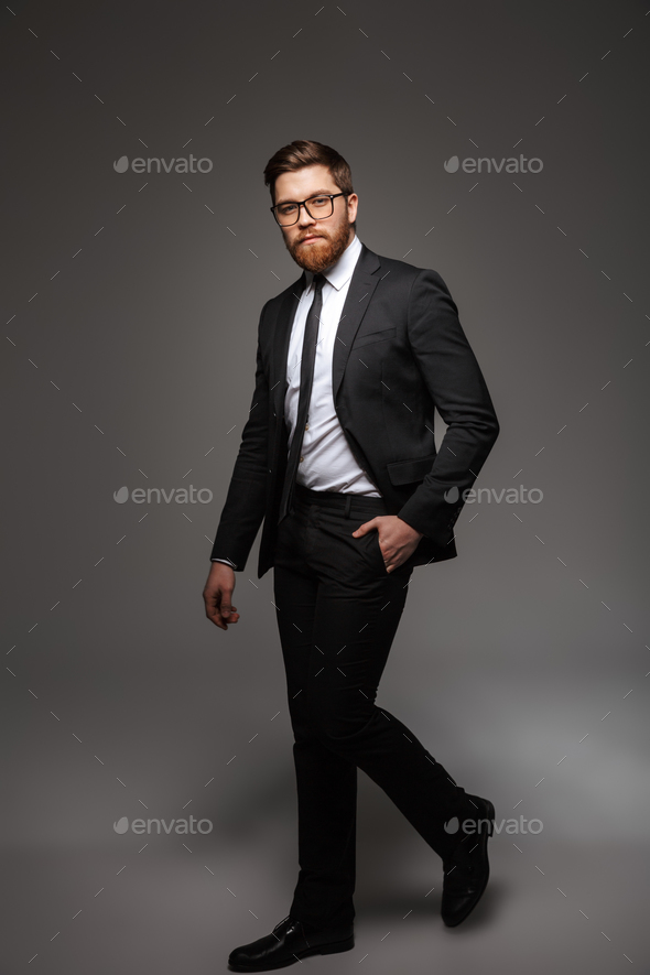 Full length portrait of a confident young businessman - Stock Photo - Images