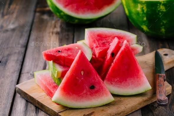 Fresh sliced watermelon on wooden rustic background - Stock Photo - Images