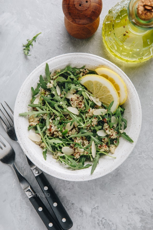 Quinoa salad with arugula and almonds. Vegetarian lunch bowl. - Stock Photo - Images