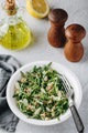 Quinoa salad with arugula and almonds. Vegetarian lunch bowl.