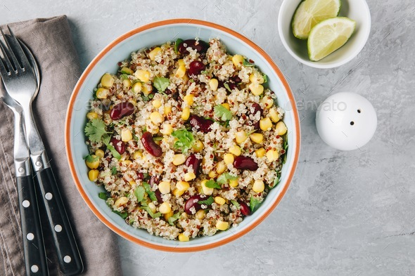Quinoa salad with sweet corn, black beans and cilantro. - Stock Photo - Images