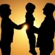 Silhouette of a Happy Family. Mother Passes the Child To Her Father. The Concept of a Happy Family - VideoHive Item for Sale