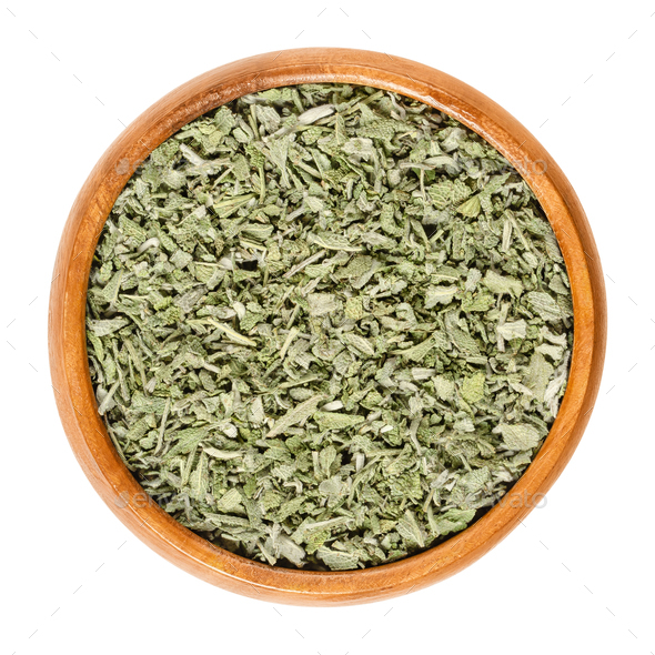 Dried sage in wooden bowl over white - Stock Photo - Images