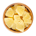 Candied pineapple pieces in wooden bowl over white - PhotoDune Item for Sale
