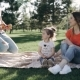 Happy Family at the Picnick. Father Brings Some Apples - VideoHive Item for Sale