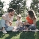 Family Picnicking Outdoors with Their Cute Daughter - VideoHive Item for Sale