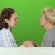 Daughter Kisses Her Mother on the Cheek and Hugs He. Green Screen. Side View - VideoHive Item for Sale