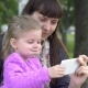 Mother and Cute Little Daughter Taking Selfie with Smartphone in the Park - VideoHive Item for Sale