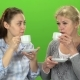 Two Women Drink Tea and Talk - VideoHive Item for Sale