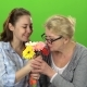 Girl with Her Mother Is Sniffing a Bouquet of Flowers. Green Screen - VideoHive Item for Sale