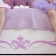 Little Girls in Dresses Sitting on the Bed and Chatting Legs. - VideoHive Item for Sale